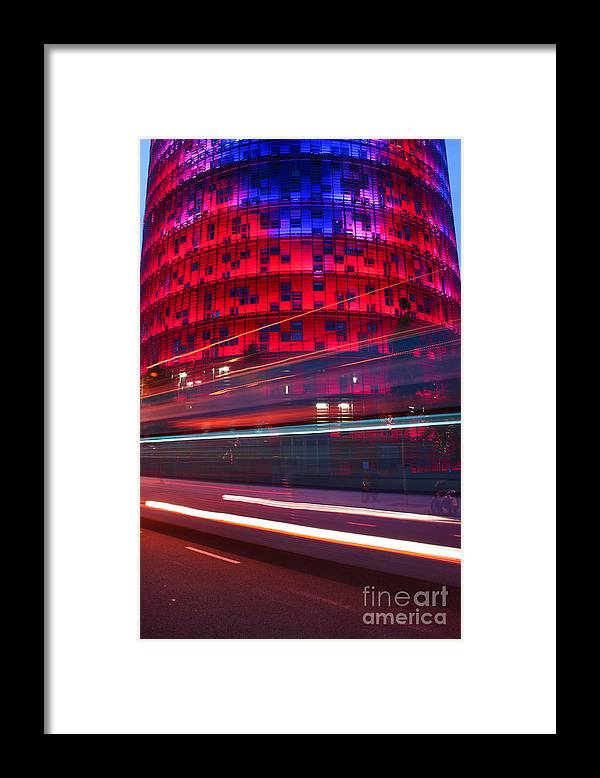 Agbar Tower Framed Print featuring the photograph Barcelona's Agbar Tower With Touristic Bus by Artur Debat