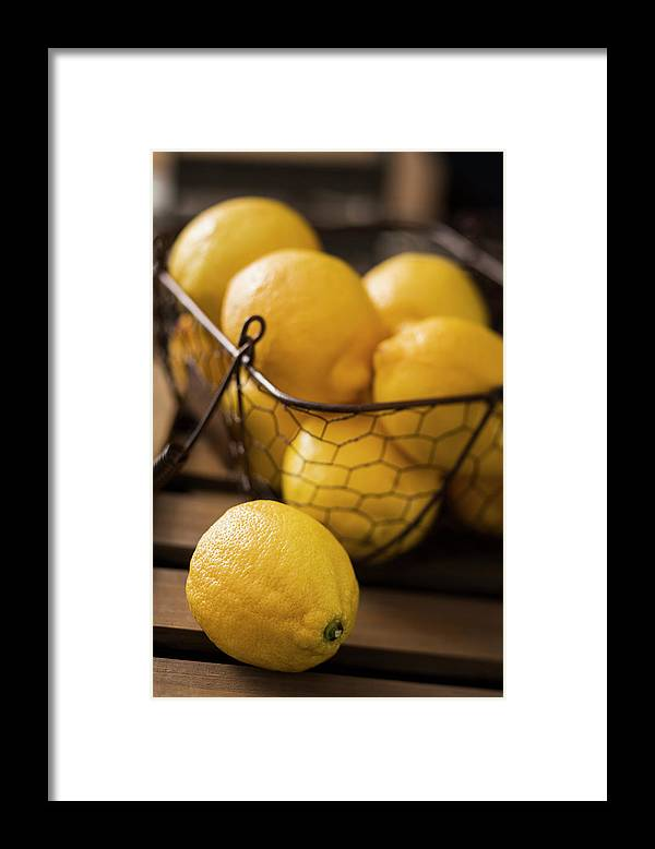 Vitamin C Framed Print featuring the photograph Basket With Organic Lemons Fresh From by Gmvozd