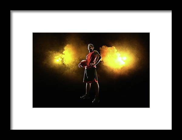 People Framed Print featuring the photograph Basketball Player On Smoky Yellow by Stanislaw Pytel