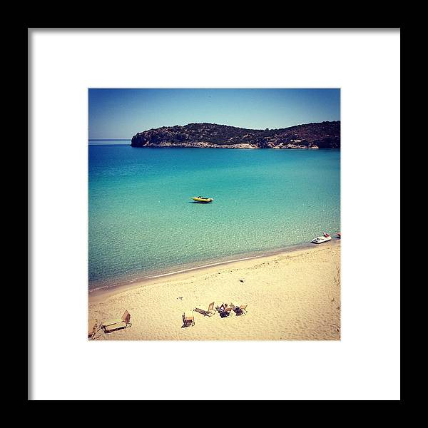Water's Edge Framed Print featuring the photograph Beach In Crete by Seiphotos