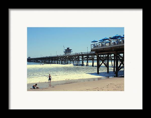 Childhood Framed Print featuring the photograph Beach View With Pier 1 by Ben and Raisa Gertsberg