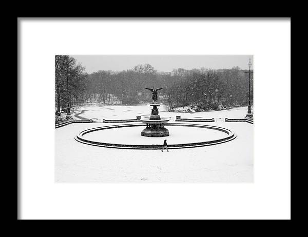 Black And White Framed Print featuring the photograph Bethesda Angel In Snow by Dave Beckerman