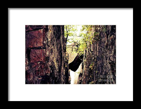 Rock Framed Print featuring the photograph Between A Rock And A Hard Place by Daryl Macintyre