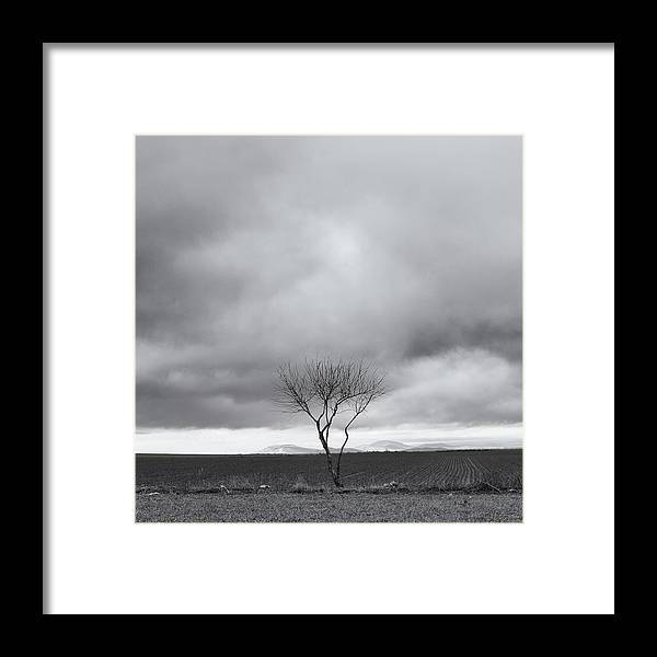 Layers Framed Print featuring the photograph Between Two Rocks by Peter Lubben