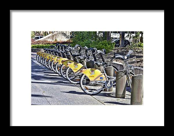 Street Photography Framed Print featuring the pyrography Bicycles by Phillip J Gordon