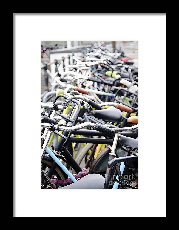Amsterdam Framed Print featuring the photograph Bicyles Parked Along The Street by Oscar Gutierrez
