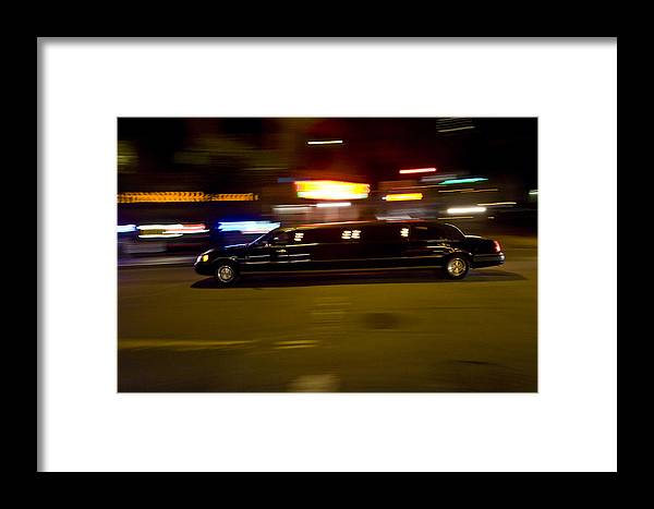 Black Limo Framed Print featuring the photograph Big Black Limo Cruising Through The City by Scott Lenhart
