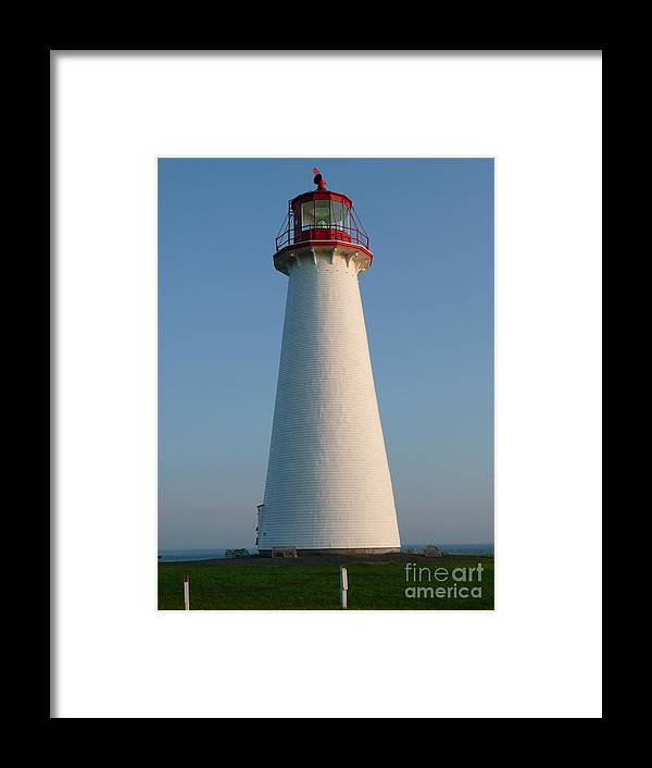White Lighthouse Framed Print featuring the photograph Big White Lighthouse by Rachel Gagne