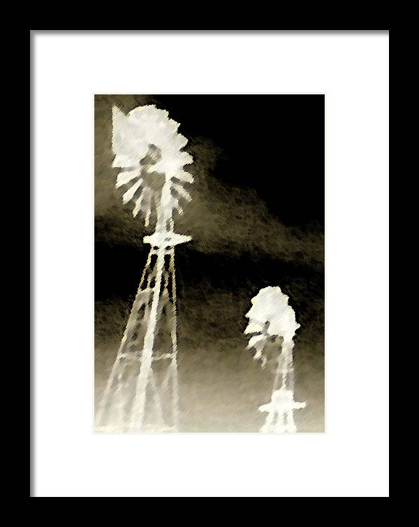 Black Framed Print featuring the photograph Bits Of Dust In The Wind by Max Mullins