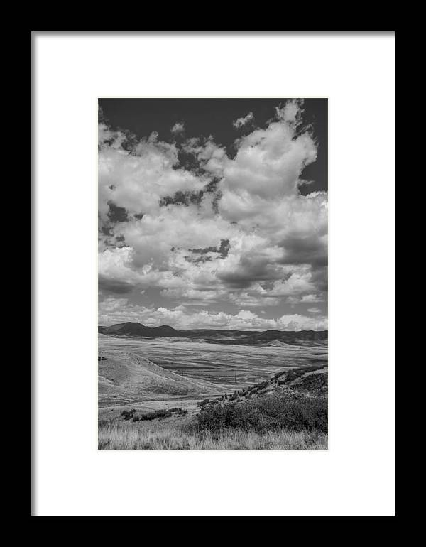Cumulus Clouds Framed Print featuring the photograph Black And White High Desert Cumulus by Aaron Burrows