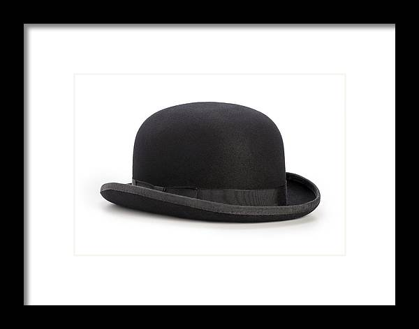 ec6cf028f25 White Background Framed Print featuring the photograph Black Bowler Hat  Isolated On A White Background by