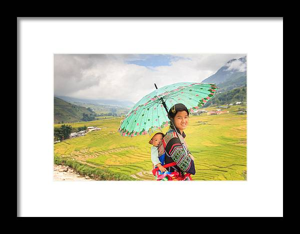 Black H'mong Framed Print featuring the photograph Black H'mong With Son by Roger Fonts