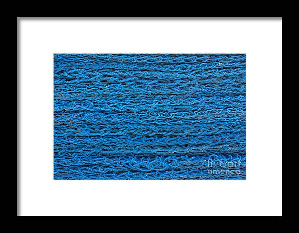 Background Framed Print featuring the photograph Blue Rope Stack by Jannis Werner
