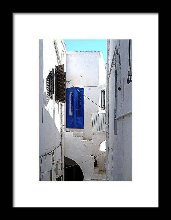 Blue Window Framed Print featuring the photograph Blue Window by Gianmarco Cicuzza