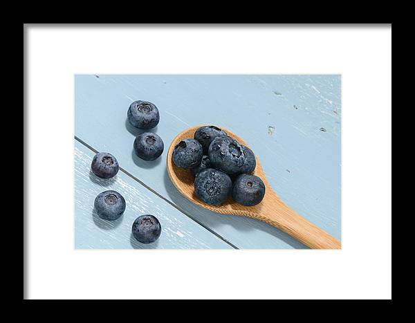 Berry Framed Print featuring the photograph Blueberries On A Spoon by Brandon Bourdages