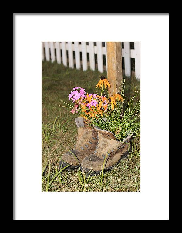 Flowers Framed Print featuring the photograph Boots In Bloom by Victoria Dauphinee