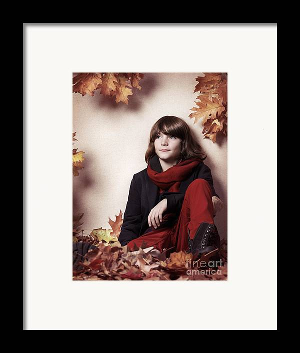 Boy Framed Print featuring the photograph Boy Sitting On Autumn Leaves Artistic Portrait by Oleksiy Maksymenko