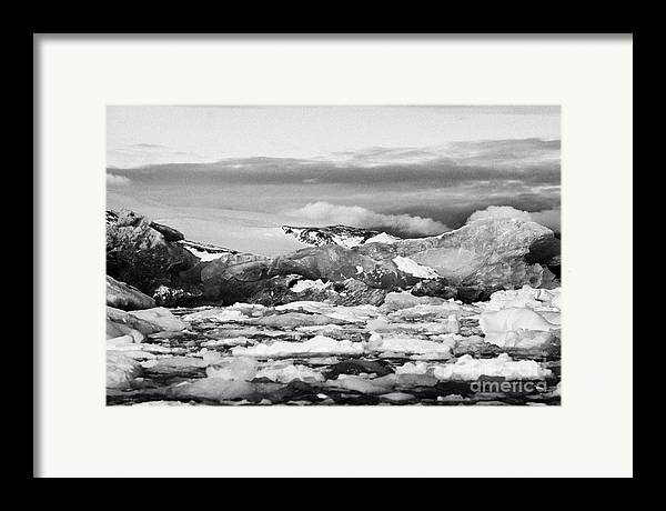 Brash Framed Print featuring the photograph brash sea pack ice forming together with dirty blue iceberg as winter approaches cierva cove Antarct by Joe Fox