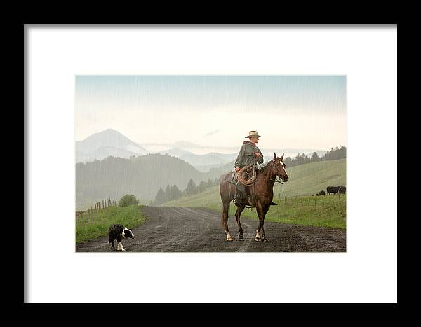 Cowboy Framed Print featuring the photograph Braving The Rain by Todd Klassy