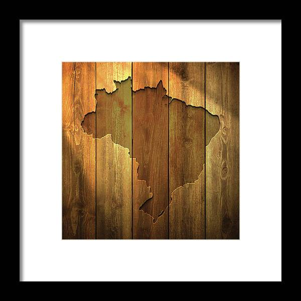 Material Framed Print featuring the digital art Brazil Map On Lit Wooden Background by Bgblue