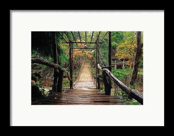 Bridge Framed Print featuring the photograph Bridge Over Waterfall by Nawarat Namphon