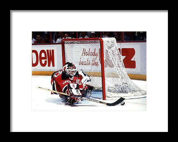 National Hockey League Framed Print featuring the photograph Brodeur stops Flyers by B Bennett