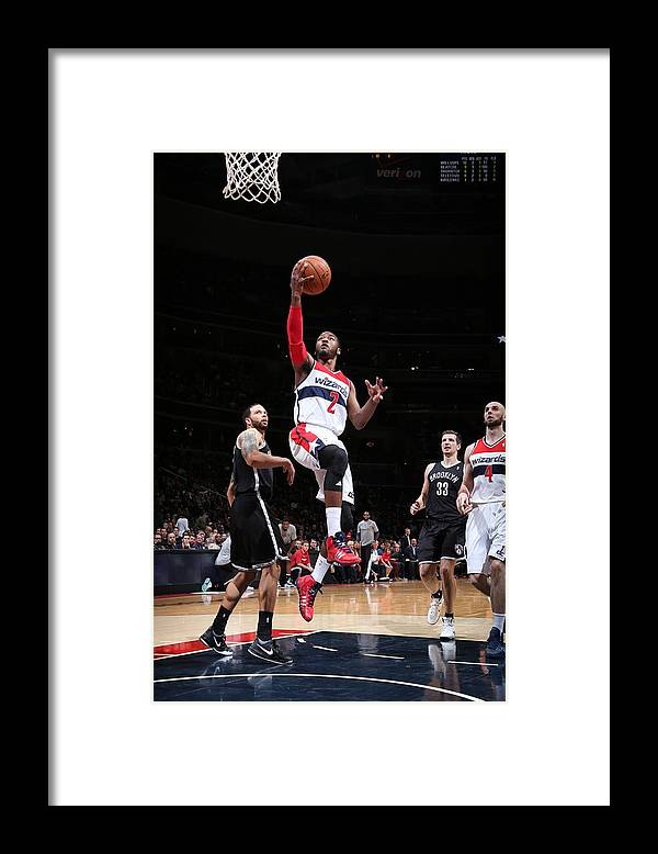 Nba Pro Basketball Framed Print featuring the photograph Brooklyn Nets V Washington Wizards by Ned Dishman