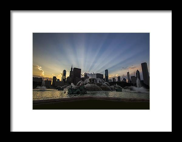 Chicago Skyline Framed Print featuring the photograph Buckingham Fountain With Rays Of Sunlight by Sven Brogren