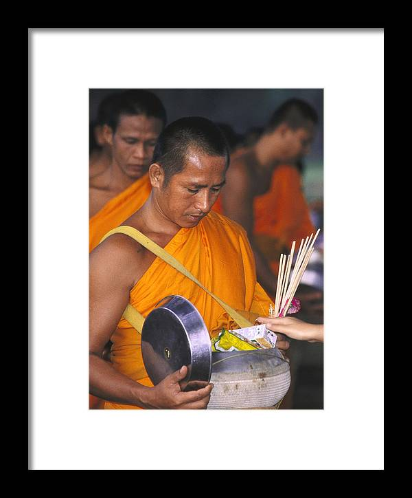 Alms Framed Print featuring the photograph Buddhist Monks Receiving Alms by Richard Berry