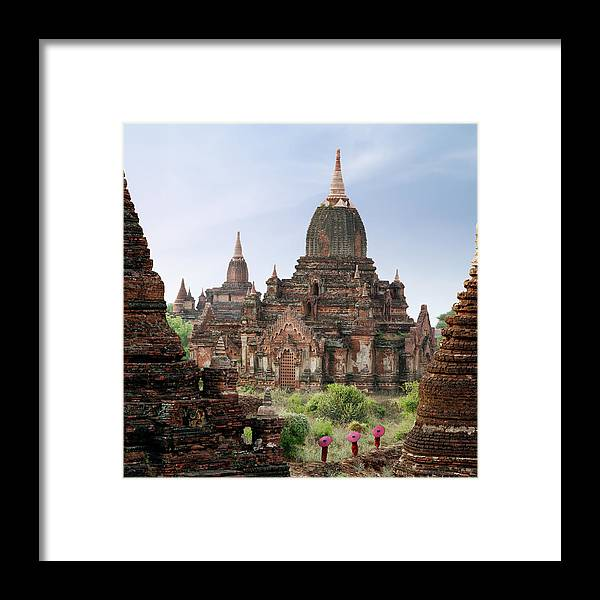 Tranquility Framed Print featuring the photograph Buddhist Monks Walking Past Temple by Martin Puddy