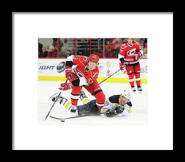 229745157 North Carolina Framed Print featuring the photograph Buffalo Sabres V Carolina  Hurricanes by Grant Halverson