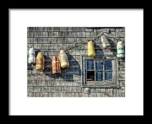 Boat House Framed Print featuring the photograph Buoys On A Wall At Peggys Cove by Rob Huntley