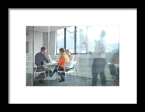 Young Men Framed Print featuring the photograph Businesspeople Having Meeting At by Zero Creatives