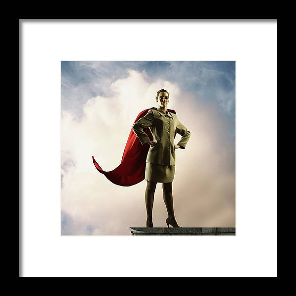 Toughness Framed Print featuring the photograph Businesswoman with cape by Colin Anderson