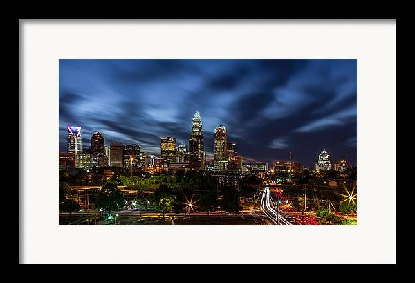Charlotte Skyline Captured 04/13/12. Framed Print featuring the photograph Busy Charlotte Night by Chris Austin