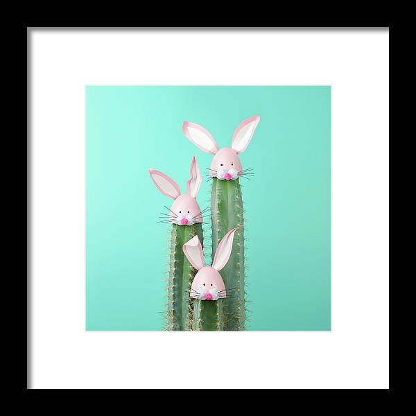 Easter Bunny Framed Print featuring the photograph Cactus With Easter Rabbit Decorations by Juj Winn