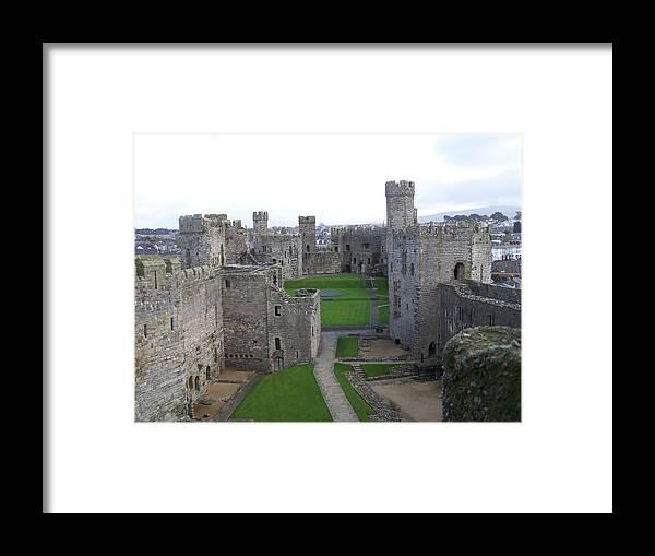 Castles Framed Print featuring the photograph Caernarfon Castle by Christopher Rowlands