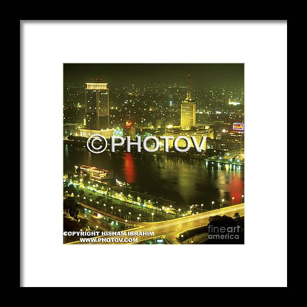 Cairo Framed Print featuring the photograph Cairo And The Nile River At Night - Egypt by Hisham Ibrahim