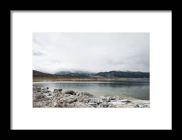 Tranquility Framed Print featuring the photograph Calm Lake Against Mountain Range by Christian Soldatke / EyeEm