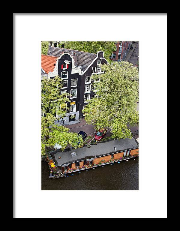 Amsterdam Framed Print featuring the photograph Canal Houses And Houseboat In Amsterdam by Artur Bogacki