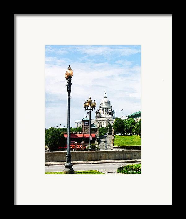 Lamp Framed Print featuring the photograph Capitol Building Seen From Waterplace Park by Susan Savad