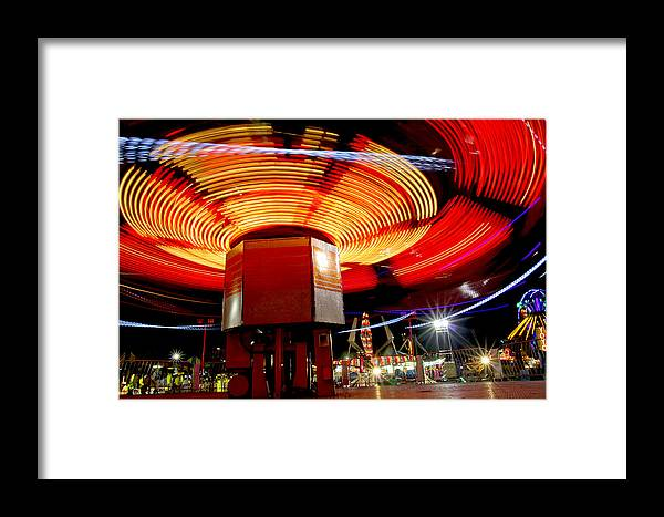 Carnival Framed Print featuring the photograph Carnival Ride 3 by David DeCenzo