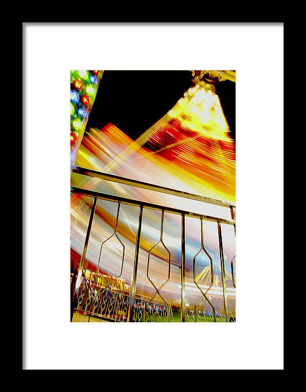 Carnival Framed Print featuring the photograph Carnival Ride Fence by David DeCenzo
