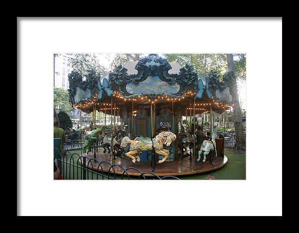 Carousel Framed Print featuring the photograph Carousel by Rick De Wolfe