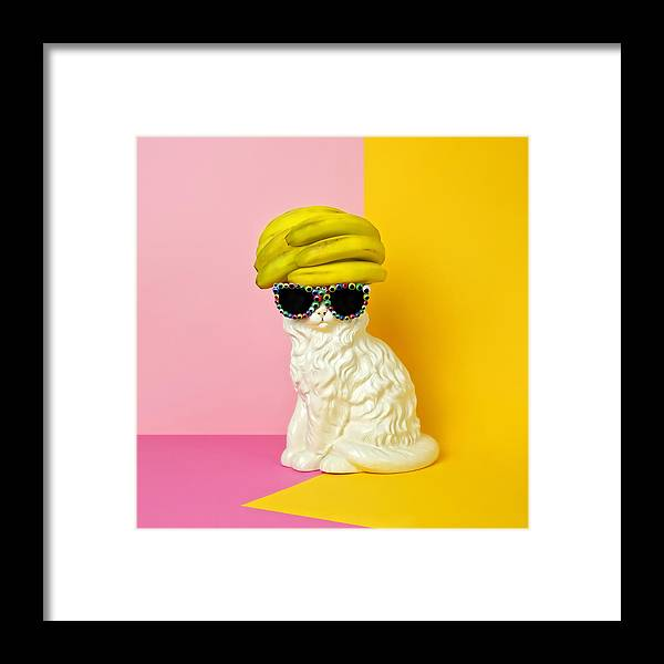 Statue Framed Print featuring the photograph Cat Wearing Sunglasses And Banana Wighat by Juj Winn