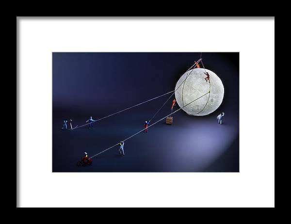 Planetary Moon Framed Print featuring the photograph Catch The Moon by Antonio Iacobelli