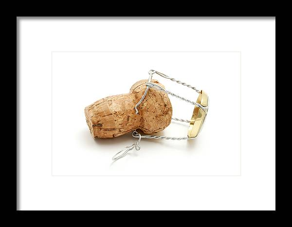 White Background Framed Print featuring the photograph Champagne Cork Stopper by Fabrizio Troiani
