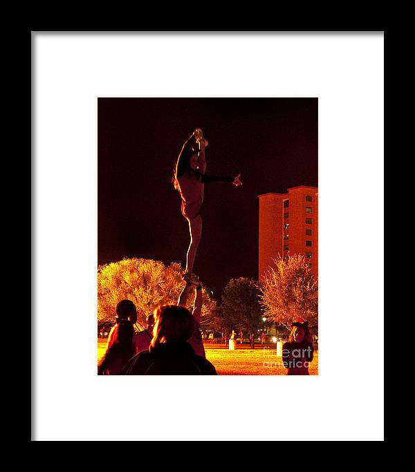 Cheer Leaders At Texas Tech Home Coming Framed Print featuring the photograph Cheer Leaders At Texas Tech Home Coming by Mae Wertz