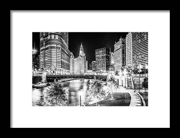 America Framed Print featuring the photograph Chicago River Buildings at Night in Black and White by Paul Velgos