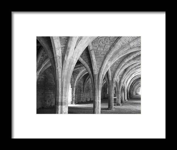 Arches Framed Print featuring the photograph Church Archways In Black And White by Susan Leonard